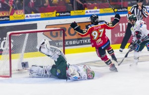 11616389-lulea-sweden-march-18-2015-per-ledin-97-lulea-hockey-scores-swedish-hockey-league-game-between-lulea-hockey-and-frolunda-indians
